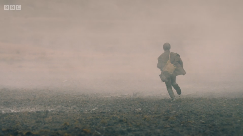 child runs away into the smoke
